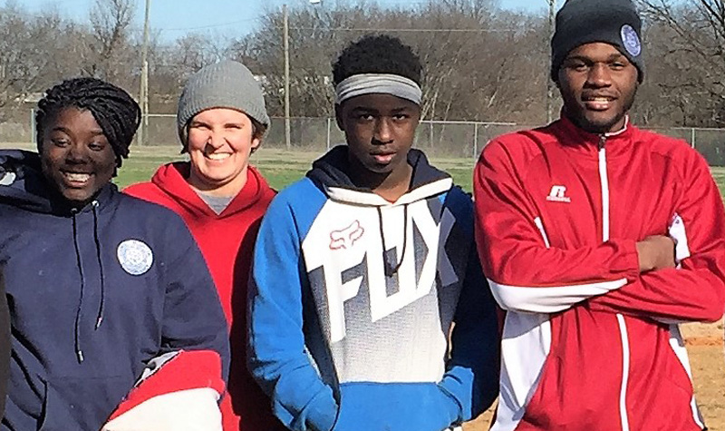 Ashley Cofield with students on baseball field