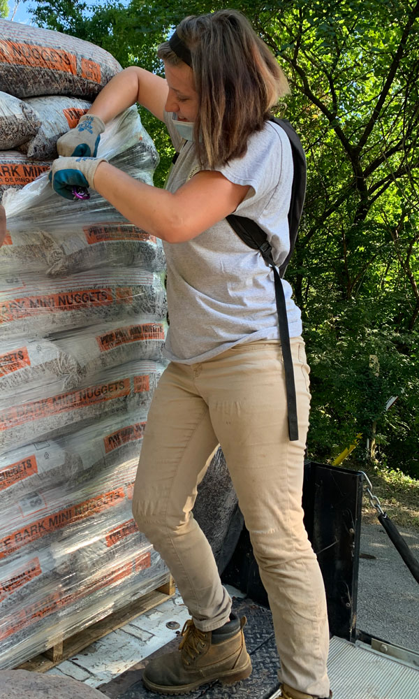 Intern Breanna unloading mulch