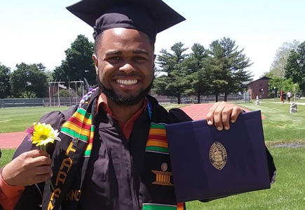 Domanique at his graduation from Knox College
