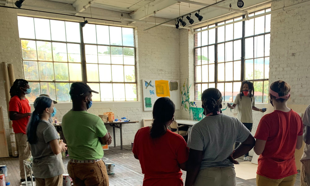 Genesis talking to the LMC interns