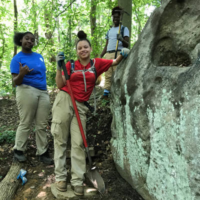 Imani and two other Interns working on one of the boulders in the bouldering park
