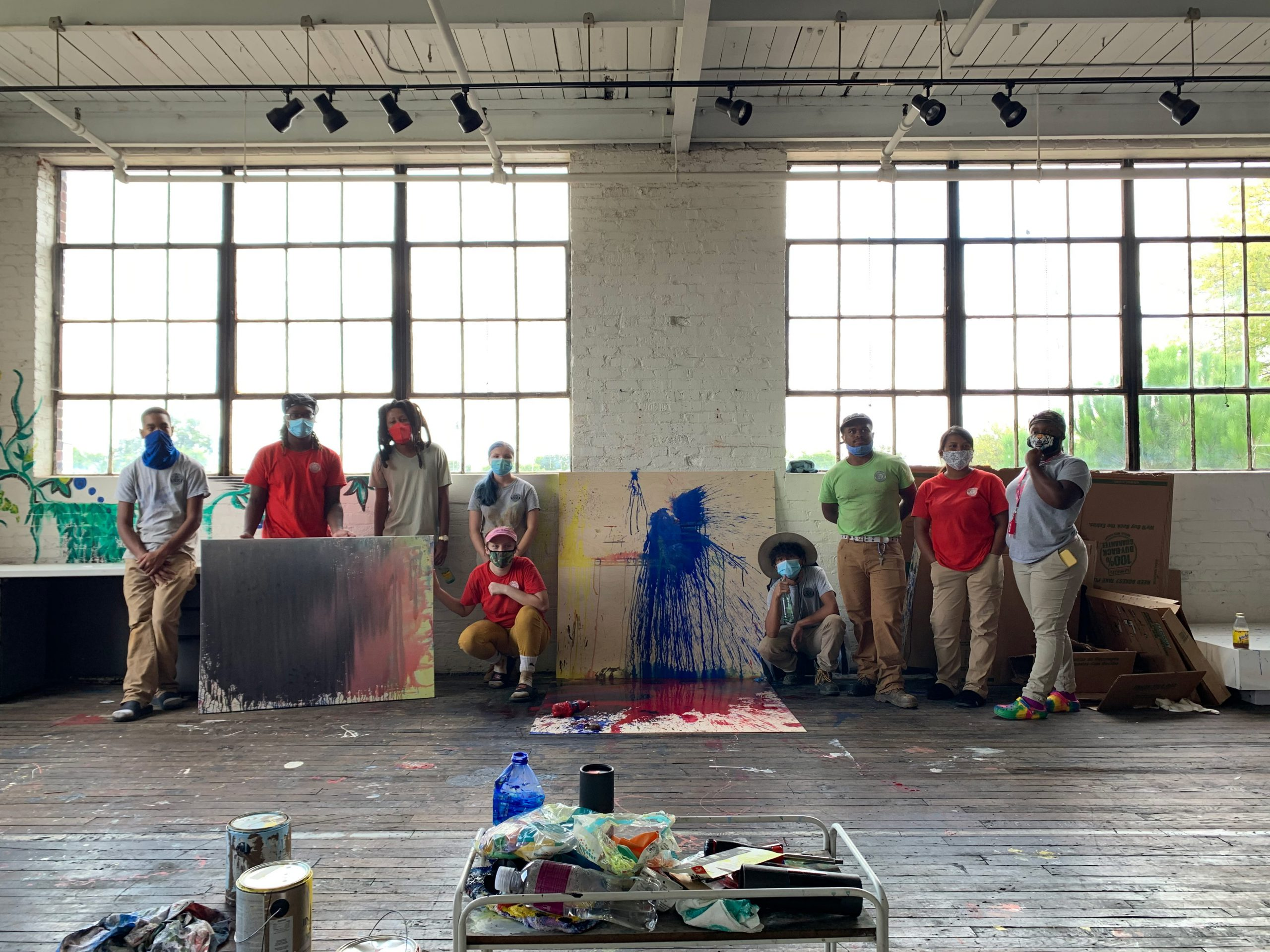 Picture of interns and Genesis after creating their original art piece