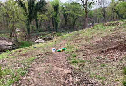 Pollinator garden after picture, cleared area with a trail outline as well