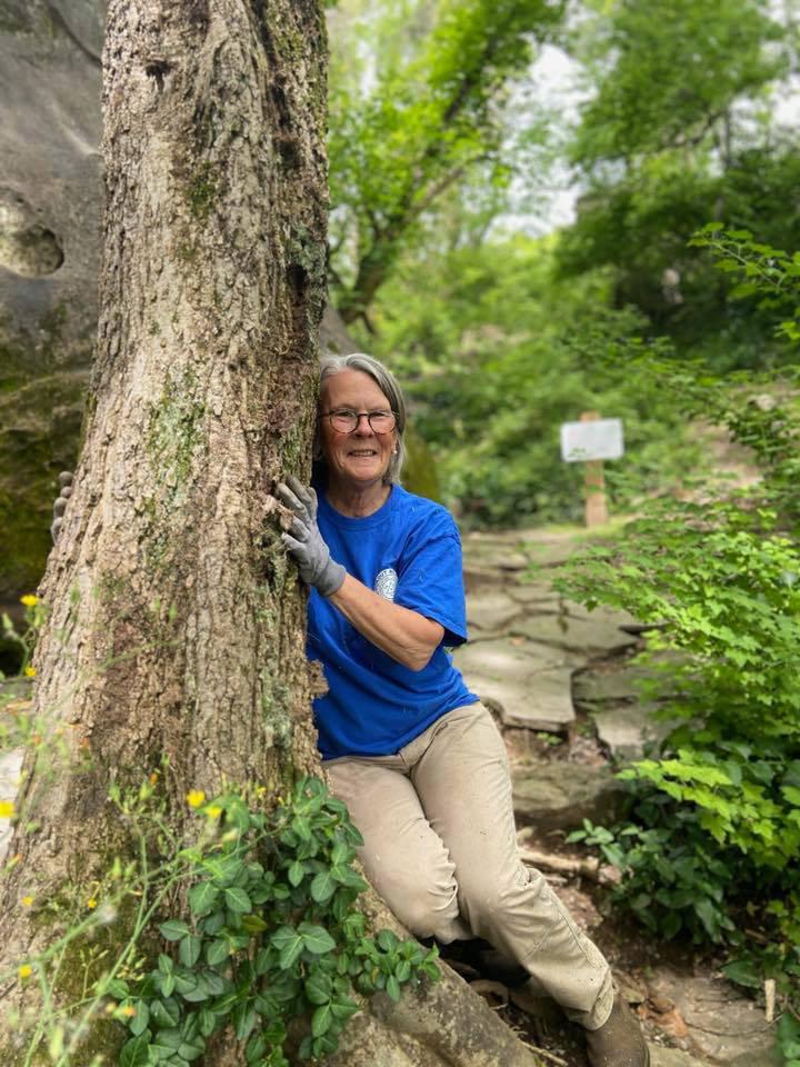 Robyn Carlton Hugging a tree on Earth Day