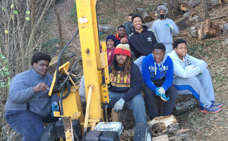 hudson school interns working a log splitter